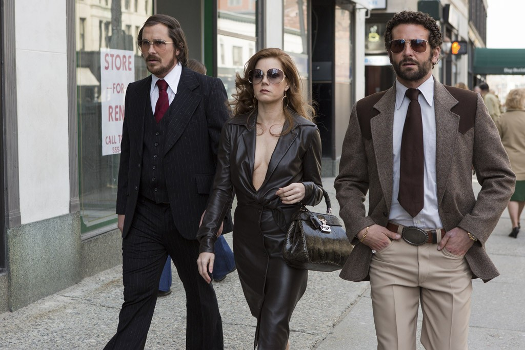 Christian Bale, Amy Adams, Bradley Cooper in American Hustle